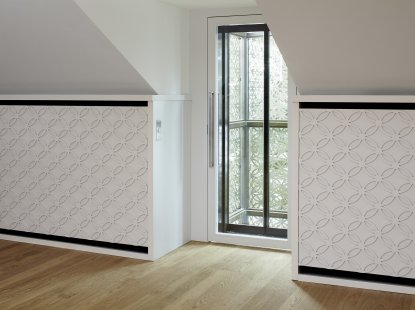 Wall panelling with an abstract braid motif